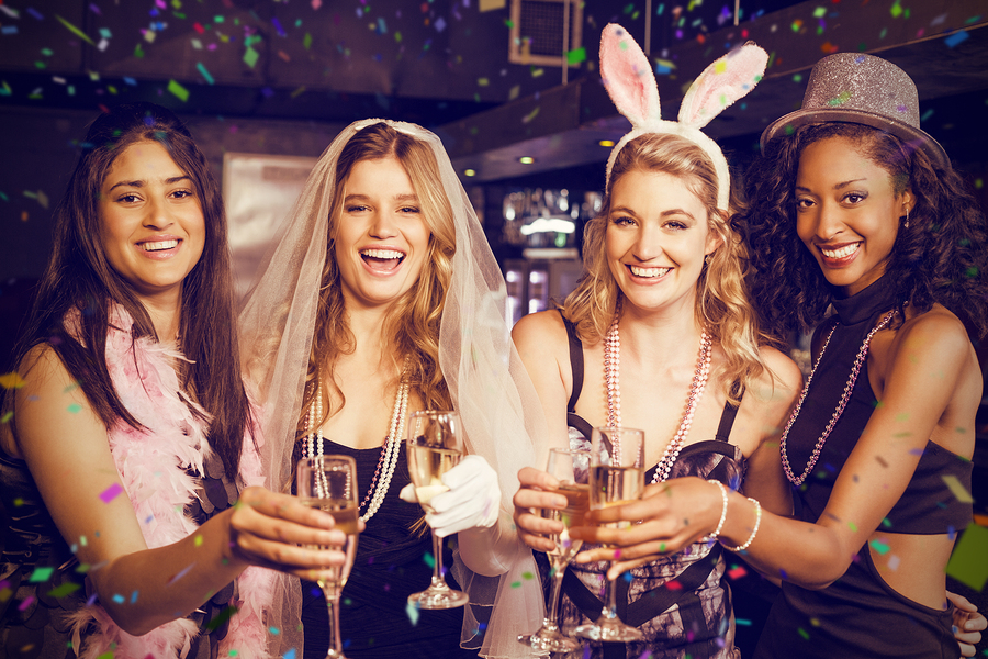 Friends celebrating bachelorette party against flying colours
